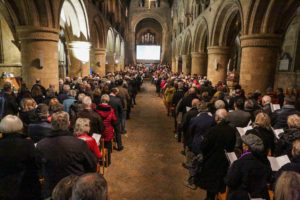 Long view of congregation seated in Southwell Minster for 20th Anniversray Service