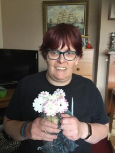Kirsty at home with the flowers she made in her Zoom craft class