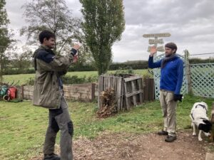 Sam recording a garlic-planting tutorial at Flower Pod