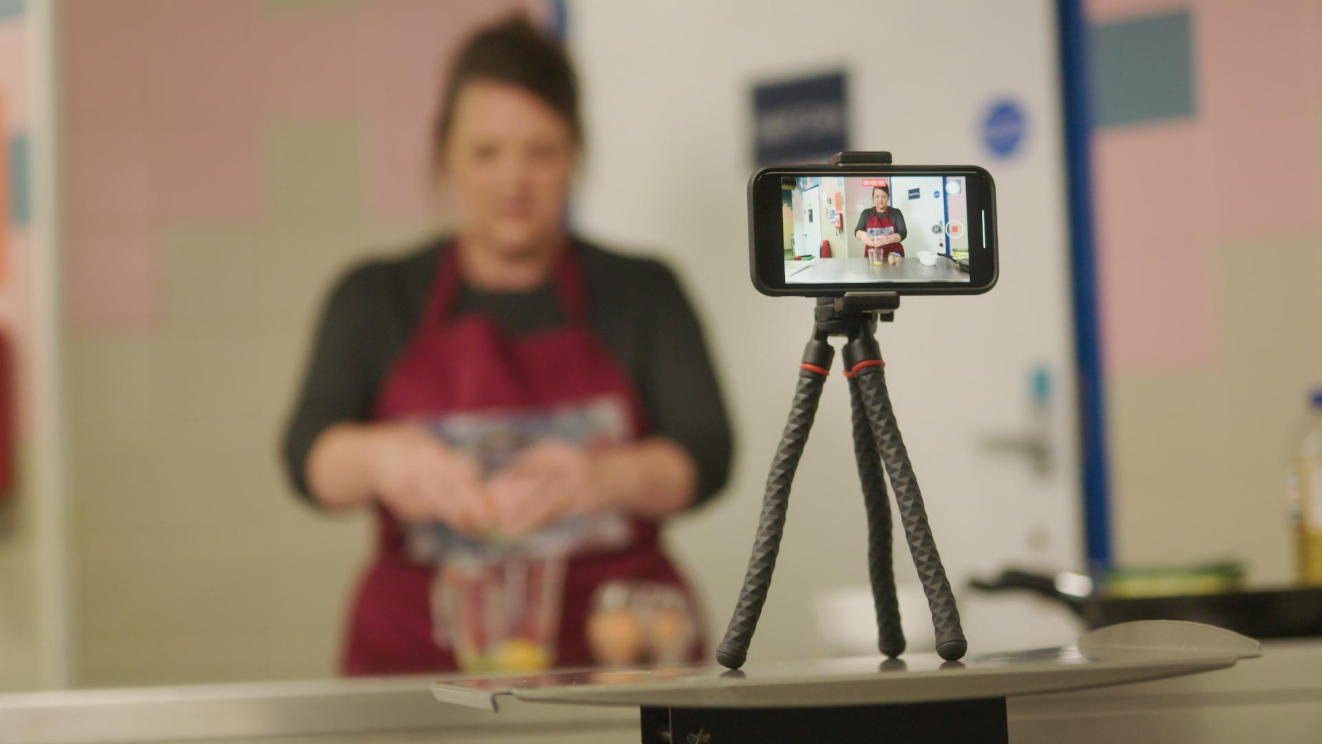 Reach Newark staff filming Tina's Tasty Treats cooking show