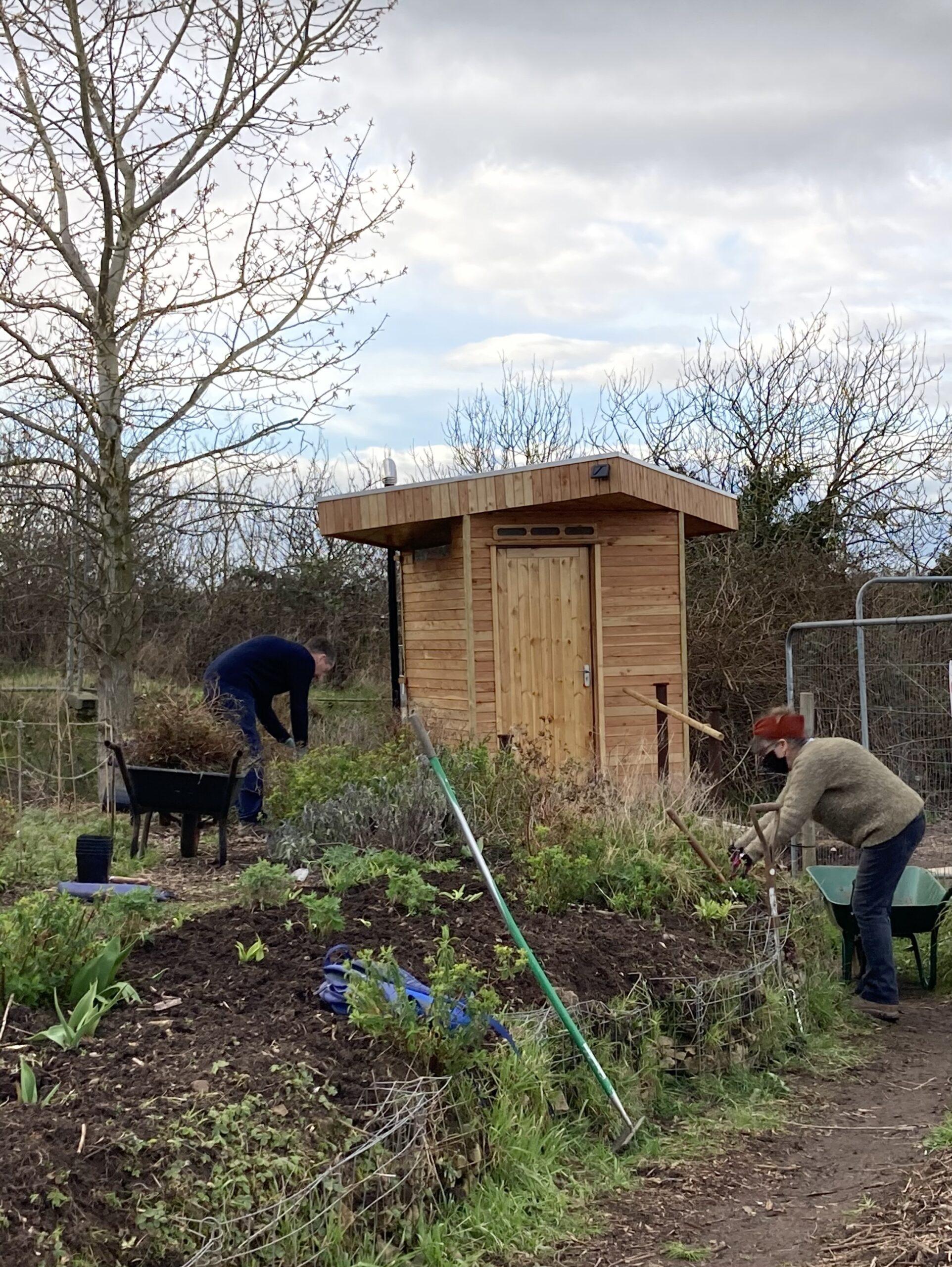 Photo of volunteers working on building Flower Pod's composting loo
