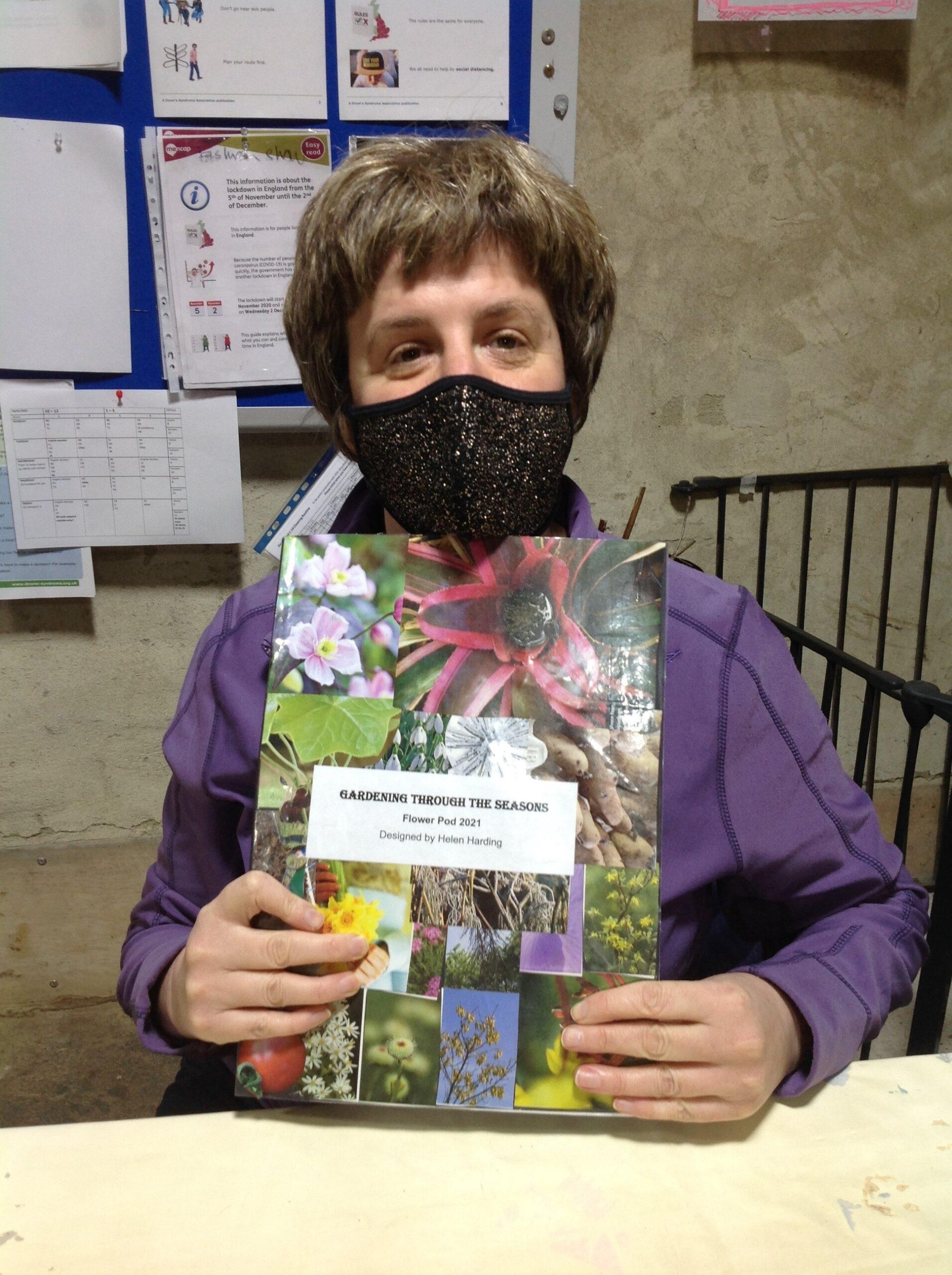 Helen holding her Flower Pod book